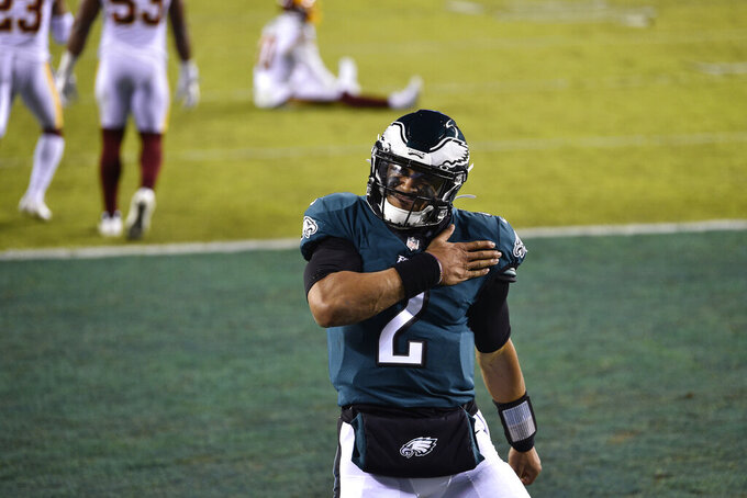 Philadelphia Eagles' Jalen Hurts celebrates after scoring a touchdown during the first half of an NFL football game against the Washington Football Team, Sunday, Jan. 3, 2021, in Philadelphia. (AP Photo/Derik Hamilton)