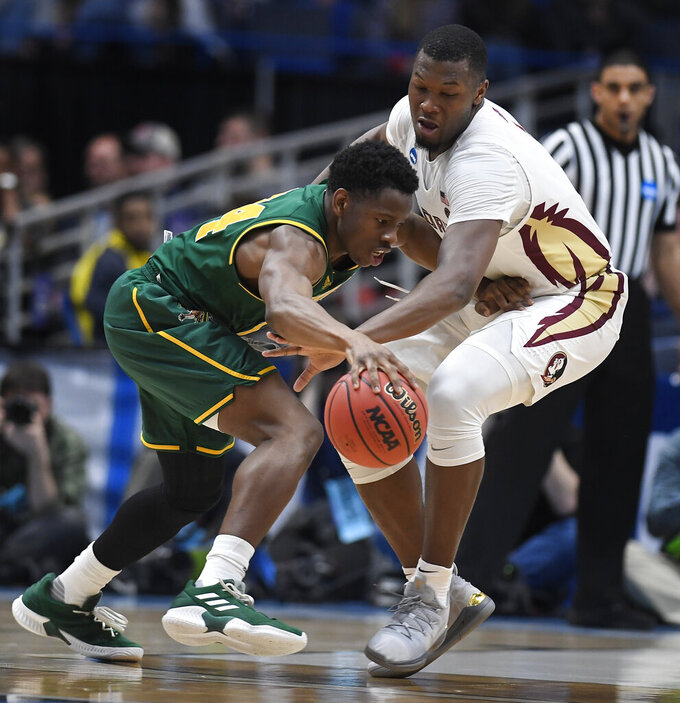 Florida State's Raiquan Gray, right, steals the ball from Vermont's Ben Shungu, left, during the second half of a first round men's college basketball game in the NCAA tournament, Thursday, March 21, 2019, in Hartford, Conn. (AP Photo/Jessica Hill)