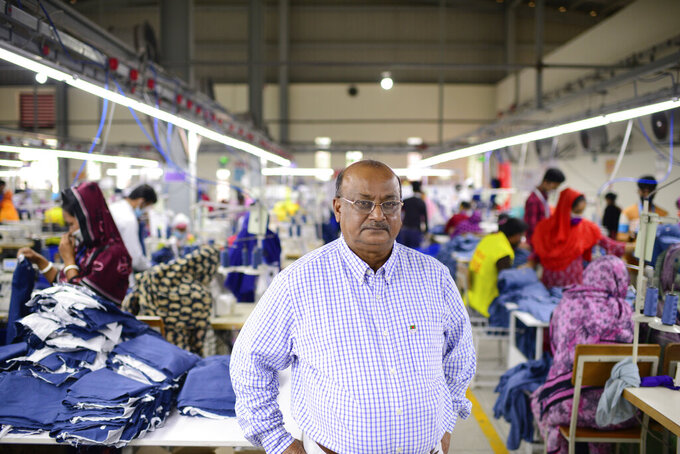 "Shafiqul Islam, 67, owner of Arrival Fashion Ltd., stands for a photograph at his factory in Gazipur, on the outskirts of capital Dhaka, Bangladesh, Saturday, March 13, 2021. Islam was studying business at Dhaka College in 1971 when a bloody and brutal war for independence ravaged Bangladesh. After undergoing guerrilla training in India, he returned to fight against Pakistani soldiers. ""In 1971, we jumped in and never looked back because we knew independence had to come. Otherwise, this nation won't survive,"" he said. ""But that wasn't the end. We still have a way to go but our heart is always with the motherland."" (AP Photo/Mahmud Hossain Opu)"