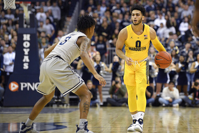 No. 15 Marquette survives Georgetown despite Howard's injury