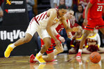 Iowa State guard Talen Horton-Tucker, left, fights for a loose ball with Texas Tech guard Matt Mooney during the first half of an NCAA college basketball game, Saturday, March 9, 2019, in Ames, Iowa. (AP Photo/Charlie Neibergall)