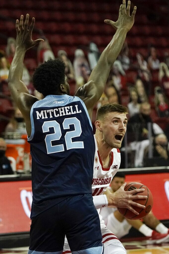 Wisconsin's Micah Potter looks to shoot past Rhode Island's Makhel Mitchell during the first half of an NCAA college basketball game Wednesday, Dec. 9, 2020, in Madison, Wis. (AP Photo/Morry Gash)