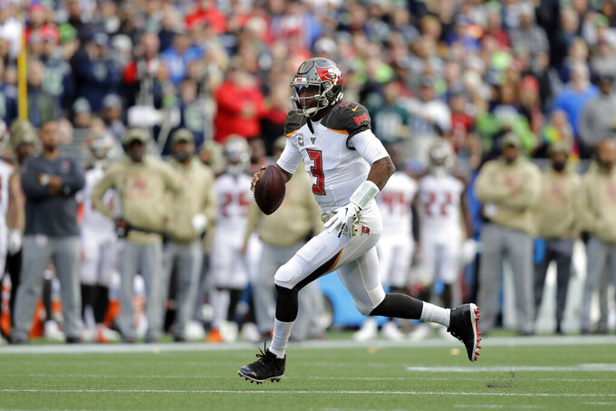 Tampa Bay Buccaneers quarterback Jameis Winston scrambles against the Seattle Seahawks during the second half of an NFL football game, Sunday, Nov. 3, 2019, in Seattle. (AP Photo/John Froschauer)