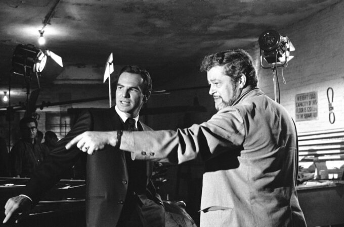 "FILE - In this May 27, 1966 file photo, actor Burt Reynolds, left, discusses a scene with director Paul Bogart during location shooting of a new ABC-TV series ""Hawk"", in New York. Reynolds, who starred in films including ""Deliverance,"" ""Boogie Nights,"" and the ""Smokey and the Bandit"" films, died at age 82, according to his agent. (AP Photo/Joe Caneva, File)"