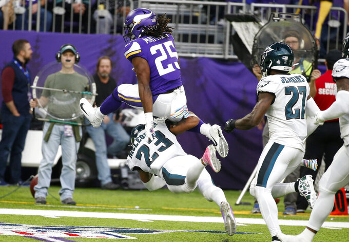Minnesota Vikings running back Alexander Mattison (25) leaps over Philadelphia Eagles free safety Rodney McLeod (23) during the second half of an NFL football game, Sunday, Oct. 13, 2019, in Minneapolis. (AP Photo/Bruce Kluckhohn)