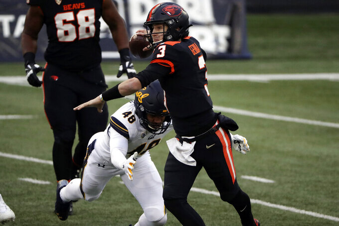 Oregon State quarterback Tristan Gebbia (3) throws a pass before being brought down by California outside linebacker Orin Patu (48) during the second half of an NCAA college football game in Corvallis, Ore., Saturday, Nov. 21, 2020. Oregon State won 31-27. (AP Photo/Amanda Loman)