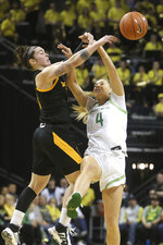 Arizona State's Robbi Ryan, left, and Oregon's Jaz Shelley battle for the ball during the second quarter of an NCAA college basketball game in Eugene, Ore., Sunday, Feb. 9, 2020. (AP Photo/Chris Pietsch)