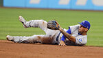 Kansas City Royals' Humberto Arteaga looks toward second base after tossing the ball to try and get Cleveland Indians' Carlos Santana out in the sixth inning of a baseball game, Saturday, July 20, 2019, in Cleveland. Santana was safe at second base. (AP Photo/Tony Dejak)