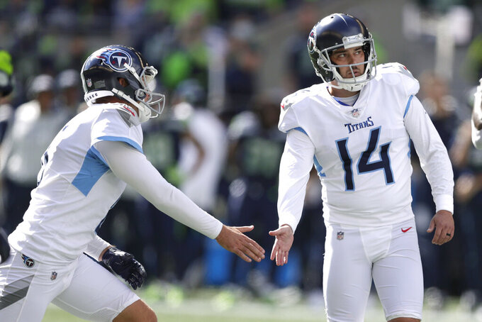 Tennessee Titans kicker Randy Bullock (14) greets holder Brett Kern, left, after Bullock kicked a field goal against the Seattle Seahawks during the first half of an NFL football game, Sunday, Sept. 19, 2021, in Seattle. (AP Photo/John Froschauer)