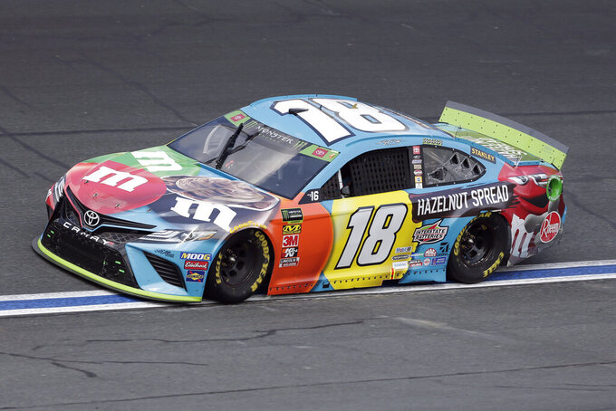 Kyle Busch drives through Turn 4 during the NASCAR Cup Series auto race at Charlotte Motor Speedway in Concord, N.C., Sunday, Sept. 29, 2019. (AP Photo/Gerry Broome)