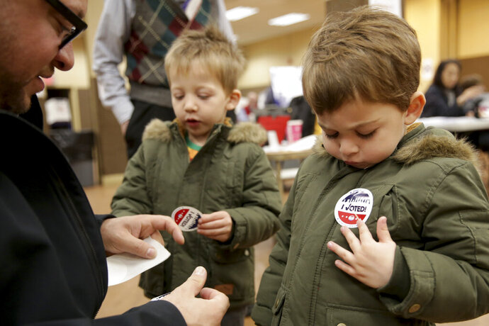 Twins Amir, right, and Milo Klatzkin, 3, put on their