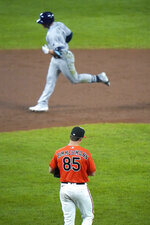 Baltimore Orioles starting pitcher Bruce Zimmerman (85) walks behind the mound after allowing a solo home run to Tampa Bay Rays' Hunter Renfroe, top, during the third inning of the second game of a baseball doubleheader, Thursday, Sept. 17, 2020, in Baltimore. (AP Photo/Julio Cortez)