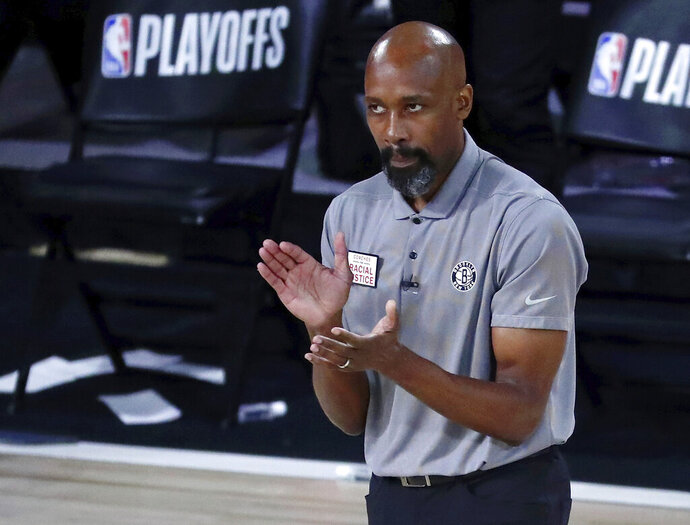 Brooklyn Nets head coach Jacque Vaughn reacts to a play during the second half in Game 3 of an NBA basketball first-round playoff series against the Toronto Raptors, Friday, Aug. 21, 2020, in Lake Buena Vista, Fla. (Kim Klement/Pool Photo via AP)