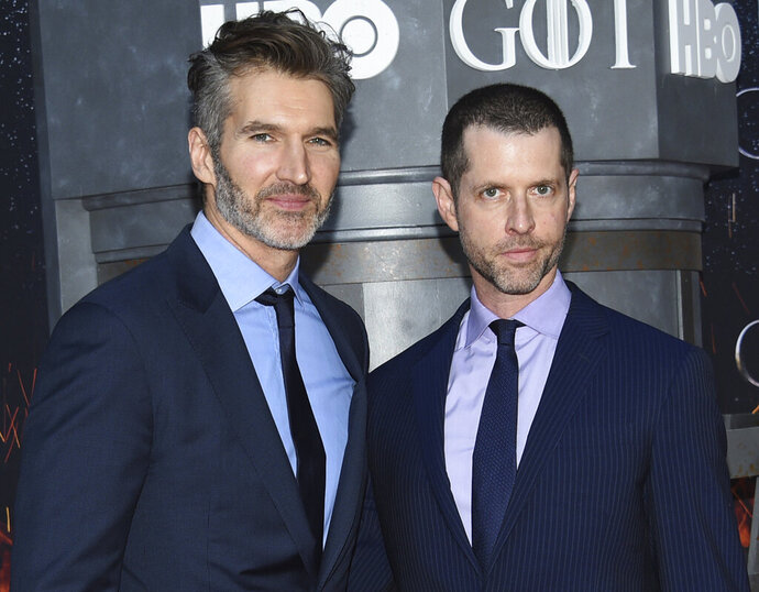 FILE - In this Wednesday, April 3, 2019, file photo, creator/executive producers David Benioff, left, and D. B. Weiss attend HBO's