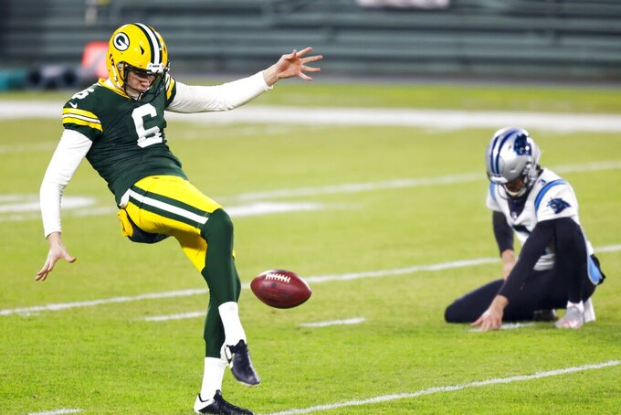 Green Bay Packers' J.K. Scott warms up before an NFL football game against the Carolina Panthers Saturday, Dec. 19, 2020, in Green Bay, Wis. (AP Photo/Matt Ludtke)