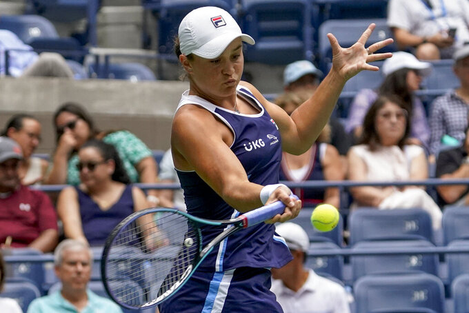 Ashleigh Barty, of Australia, returns a shot to Vera Zvonareva, of Russia, during the first round of the US Open tennis championships, Tuesday, Aug. 31, 2021, in New York. (AP Photo/John Minchillo)