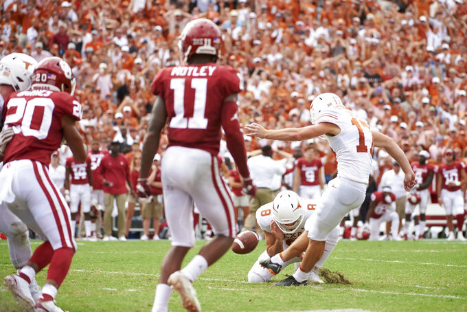 Texas kicker Cameron Dicker (17) kicks the game-winning field goal in the closing seconds of the second half of an NCAA college football game against Oklahoma at the Cotton Bowl, Saturday, Oct. 6, 2018, in Dallas. Texas won 48-45. (AP Photo/Cooper Neill)