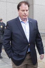 Stephen Calk leaves Federal court, Thursday, May 23, 2019, in New York. Calk charged in New York with issuing loans to win a role in President Donald Trump's administration has pleaded not guilty. (AP Photo/Mary Altaffer)