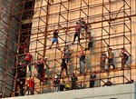Anti-government protesters climb a building near Tahrir Square during ongoing protests in Baghdad, Iraq, Wednesday, Oct. 30, 2019. (AP Photo/Khalid Mohammed)