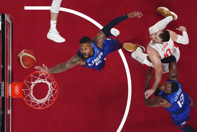 United States' Damian Lillard (6) drives to the basket past Spain's Victor Claver (10) during a men's basketball quarterfinal game at the 2020 Summer Olympics, Wednesday, July 28, 2021, in Saitama, Japan. (Brian Snyder/Pool Photo via AP)