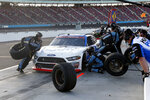 Chase Briscoe (98) makes a pit stop for tires and gas during a NASCAR Xfinity Series auto race at Phoenix Raceway, Saturday, Nov. 7, 2020, in Avondale, Ariz. (AP Photo/Ralph Freso)