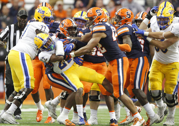 Pittsburgh's Vincent Davis (22) works for yards in the fourth quarter of the team's NCAA college football game against Syracuse in Syracuse, N.Y., Friday, Oct. 18, 2019. Pittsburgh won 27-20. (AP Photo/Nick Lisi)