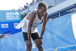 Ethiopia's Kenenisa Bekele reacts after finishing the Berlin Marathon in Berlin, Germany, Sunday, Sept. 26, 2021. (AP Photo/Lisa Leutner)