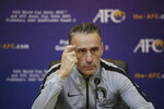 In this photo provided by the Korea Football Association, South Korea's head coach Paulo Bento listens to a question during a press conference after the Asian zone Group H qualifying soccer match against North Korea for the 2022 World Cup at Kim Il Sung Stadium in Pyongyang, North Korea, Tuesday, Oct. 15, 2019. (The Korea Football Association via AP)