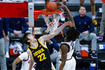 Illinois guard Ayo Dosunmu (11) gets a dunk over Iowa forward Patrick McCaffery (22) in the second half of an NCAA college basketball game at the Big Ten Conference tournament in Indianapolis, Saturday, March 13, 2021. (AP Photo/Michael Conroy)