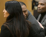 Torrey Green looks back at his family while being consoled by defense attorney Skye Lazaro, after a jury finds him guilty of eight charges including five counts of rape and a charge sexual battery in connection to reports from six women accusing him of sexual assault while he was a football player at Utah State University, Friday, Jan.18, 2019 in Brigham City, Utah. (Eli Lucero/Herald Journal via AP, Pool)