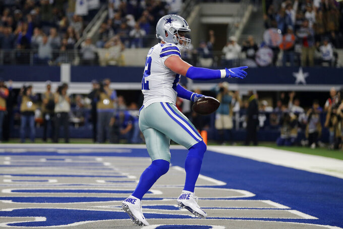 Dallas Cowboys tight end Jason Witten (82) celebrates after scoring a touchdown during the first half of an NFL football game against the Buffalo Bills in Arlington, Texas, Thursday, Nov. 28, 2019. (AP Photo/Michael Ainsworth)