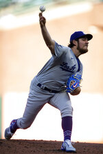 Los Angeles Dodgers starting pitcher Trevor Bauer (27) delivers against the San Francisco Giants during the first inning of a baseball game, Friday, May 21, 2021, in San Francisco. (AP Photo/D. Ross Cameron)