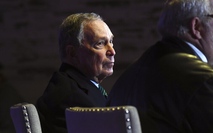 Democratic presidential contender Michael Bloomberg takes part in a gun control discussion in Aurora, Colo., on Thursday, Dec. 5, 2019. The billionaire former New York City mayor unveiled a gun control policy just steps from one of Colorado's worst mass shootings, calling for a ban on all assault weapons. (AP Photo/Thomas Peipert)