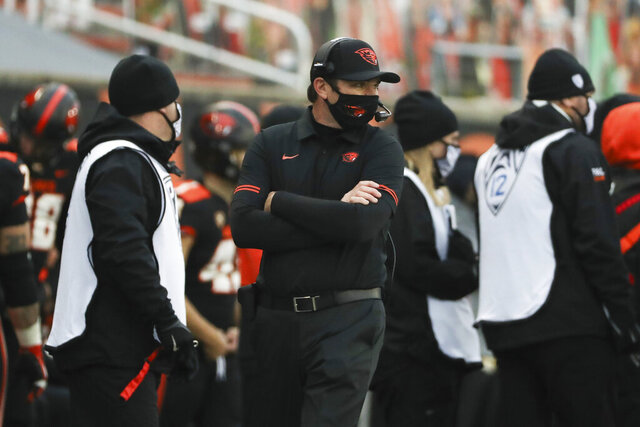 Oregon State head coach Jonathan Smith looks on during the second half of an NCAA college football game against California in Corvallis, Ore., Saturday, Nov. 21, 2020. Oregon State won 31-27. (AP Photo/Amanda Loman)