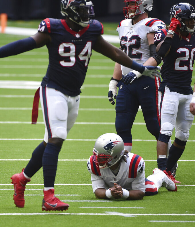 New England Patriots quarterback Cam Newton (1) reacts after failing to complete a pass on fourth down as Houston Texans defensive end Charles Omenihu (94) celebrates during the second half of an NFL football game, Sunday, Nov. 22, 2020, in Houston. (AP Photo/Eric Christian Smith)