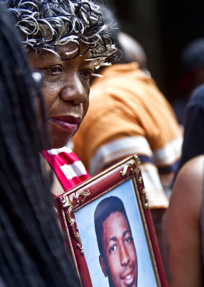 FILE - In this July 7, 2015, file photo Gwen Carr holds a picture of her son, Eric Garner, during a news conference in New York. New York City Mayor Bill de Blasio won't have to testify in a judicial inquiry into the 2014 police chokehold death of Eric Garner, a judge ruled Friday, July 23, 2021, dashing a long-running quest by Garner's relatives to have the mayor questioned under oath. (AP Photo/Bebeto Matthews, File)