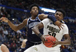 Villanova's Saddiq Bey, left, defends against a drive by Purdue's Trevion Williams (50) during the first half of a second round men's college basketball game in the NCAA Tournament, Saturday, March 23, 2019, in Hartford, Conn. (AP Photo/Elise Amendola)