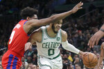 Boston Celtics forward Jayson Tatum (0) drives against Detroit Pistons guard Langston Galloway (9) in the first quarter of an NBA basketball game, Friday, Dec. 20, 2019, in Boston. (AP Photo/Elise Amendola)