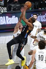 Brooklyn Nets' Kevin Durant (7) shoots over New Orleans Pelicans' Willy Hernangomez during the first half of an NBA basketball game Wednesday, April 7, 2021, in New York. (AP Photo/Frank Franklin II)
