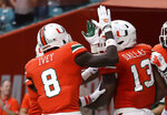 Miami running back DeeJay Dallas (13) is congratulated by defensive back DJ Ivey (8) during the first half of an NCAA college football game against Pittsburgh, Saturday, Nov. 24, 2018, in Miami Gardens, Fla. (AP Photo/Lynne Sladky)