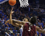 Kentucky's Immanuel Quickley, left, is fouled by Eastern Kentucky's Darius Hicks (5) during the first half of an NCAA college basketball game in Lexington, Ky., Friday, Nov. 8, 2019. (AP Photo/James Crisp)