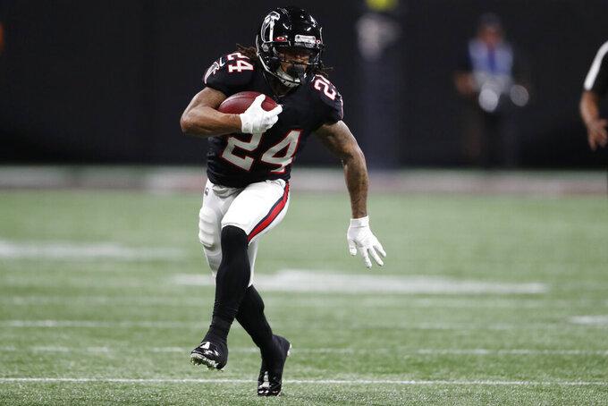 Atlanta Falcons running back Devonta Freeman (24) runs against the New Orleans Saints during the first half of an NFL football game, Thursday, Nov. 28, 2019, in Atlanta. (AP Photo/John Bazemore)