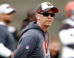 """FILE - In this May 22, 2019, file photo, then-Cleveland Browns offensive coordinator Todd Monken watches a drill during an NFL football organized team activity session at the team's training facility in Berea, Ohio. Monken believes his Georgia offense is """"just so further ahead"""" than a year ago as it enters its first full season with JT Daniels at quarterback. The offense thrived in the Bulldogs' 4-0 finish after Daniels took over as the starter last season. Now, the continuity provided by Monken's second season as offensive coordinator and Daniels' return has fueled No. 5 Georgia's championship hopes for 2021. (AP Photo/Ron Schwane, File)"""