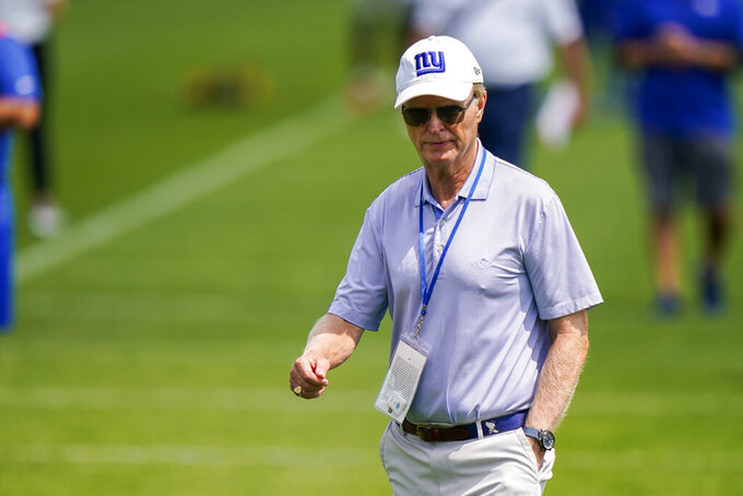 FILE - New York Giants president and CEO John Mara looks on at NFL football training camp in East Rutherford, N.J., in this Wednesday, July 28, 2021, file photo. Giants owner John Mara is sick of losing and expects it to change. Giving his annual preseason state of the team talk on Tuesday, Aug. 17, 2021, Mara said the team made progress in Joe Judge's first season, better on paper heading into 2021 and now needs to prove it by winning.(AP Photo/Corey Sipkin, File)