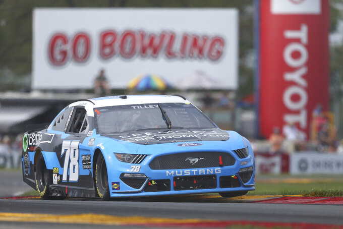 Kyle Tilley drives through the Bus Stop during a NASCAR Cup Series auto race in Watkins Glen, N.Y., on Sunday, Aug. 8, 2021. (AP Photo/Joshua Bessex)