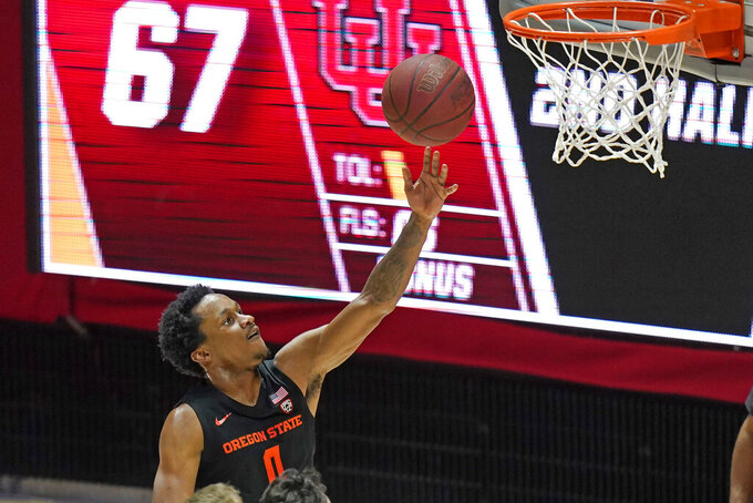 Oregon State guard Gianni Hunt shoots during the second half of the team's NCAA college basketball game against Utah on Wednesday, March 3, 2021, in Salt Lake City. (AP Photo/Rick Bowmer)