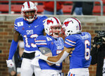 SMU wide receiver Austin Upshaw (6) is congratulated by quarterback Shane Buechele (7) after scoring a touchdown during the second half of the team's NCAA college football game against Navy, Saturday, Oct. 31, 2020, in Dallas. (AP Photo/Brandon Wade)