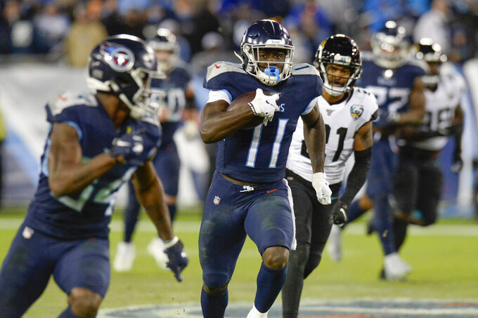 Tennessee Titans wide receiver A.J. Brown (11) scores a touchdown on a 65-yard pass reception against the Jacksonville Jaguars in the second half of an NFL football game Sunday, Nov. 24, 2019, in Nashville, Tenn. (AP Photo/Mark Zaleski)