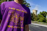 Levi Hess, of Hershey, wears a Three Mile Island shirt from the 1980's, before a press conference on the shut down of the power plant at the training center across the street on Friday, Sept. 20, 2019, in Harrisburg, Pa. (Joe Hermitt/The Patriot-News via AP)