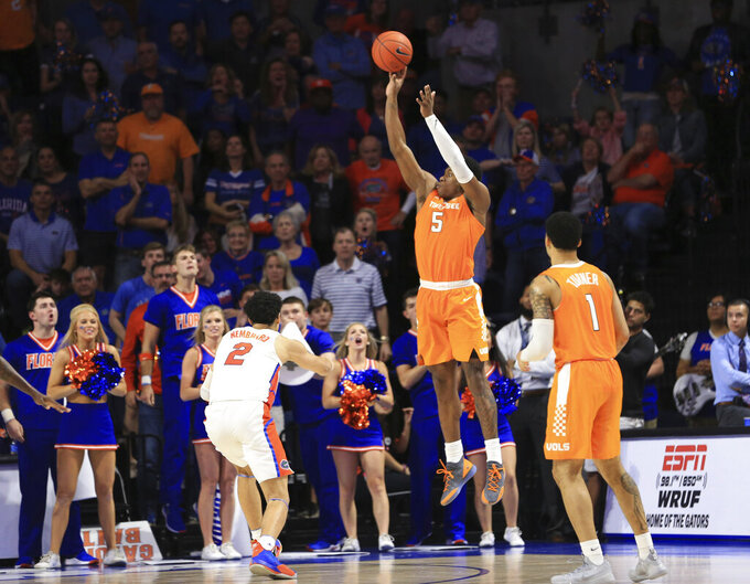 Tennessee guard Admiral Schofield (5) makes a 3-pointer over Florida guard Andrew Nembhard (2) in the final minute of an NCAA college basketball game Saturday, Jan. 12, 2019, in Gainesville, Fla. (AP Photo/Matt Stamey)